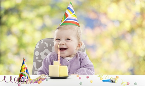 baby having her first birthday,  blurred background